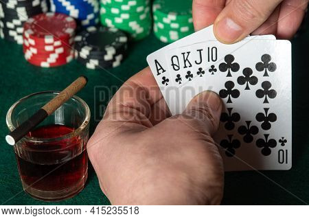 Poker Cards With Royal Flush Combination. Close Up Of Gambler Hand Is Holding Playing Cards In Poker