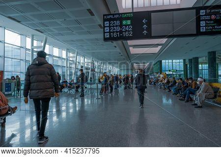 Gaziemir, Izmir, Turkey - 03.11.2021: Air Passengers With Protective Masks Wait On Seats In Front Of