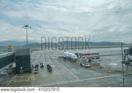 Gaziemir, Izmir, Turkey - 03.11.2021: Airplane Of Anadolu Jet Airlines Waiting To Fly In A Rainy Day
