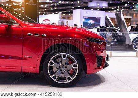 Nonthaburi, Thailand - March 25,2021 : Side View Of Maserati Levante Red Color On Display At Thailan