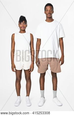 Couple in white tank top and shorts with design space loungewear fashion