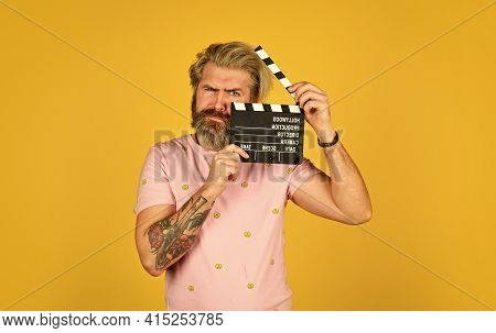 Bearded Guy With Film Making Clapperboard. Movie Time. Film Director Concept. Catch The Feeling. Pro