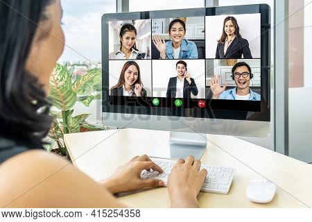 Back View Of Female Employee Speak Talk On Video Call With Colleagues On Online Event Briefing, Woma