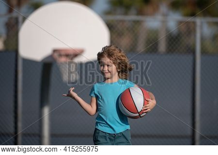 Cute Child Playing Basketball. Active Kids Lifestyle. Little Child Boy Playing Basket Ball. Basketba