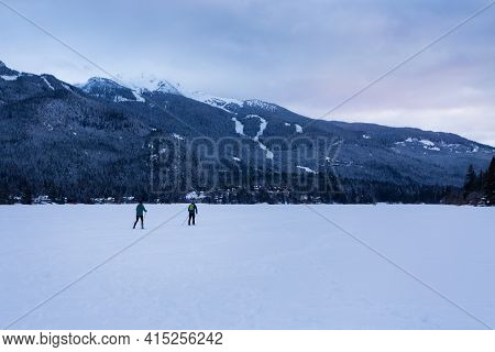 Cross Country Skier On Frozen Winter Lake In Whistler, Bc.