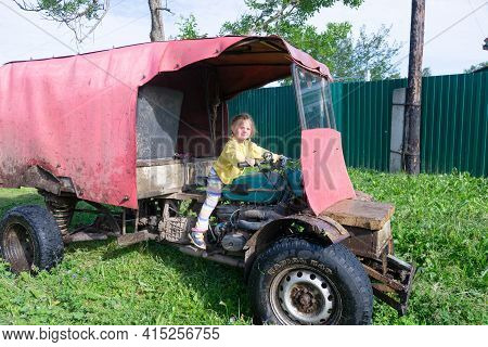 Russia - July 24, 2020. Tver Region, Russia.  The Child Is Sitting At The Wheel Of A Self-made Vehic