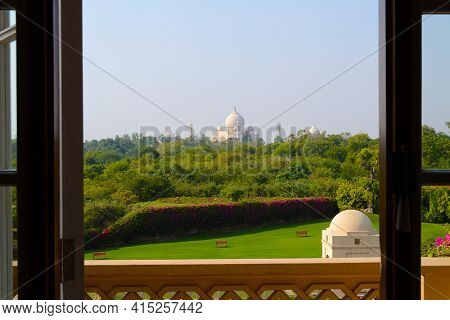 AGRA, INDIA - NOVEMBER 11, 2015: Taj Mahal seen from the Amervilas Resort and Spa. The resort is part of the Oberoi chain of luxury hotels.