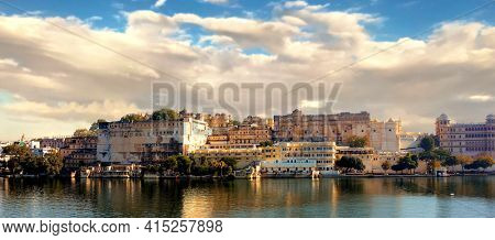 City Palace, located on Lake Pichola and built in a flamboyant style, is considered the largest of its type in the state of Rajasthan.