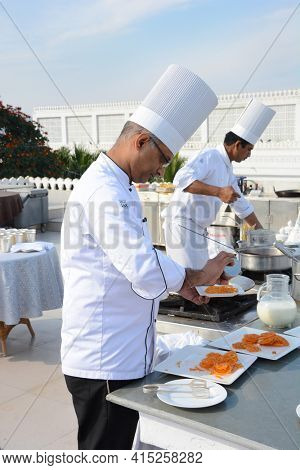 UDAIPUR, INDIA - JANUARY 13, 2017: Chef preparing treats at the Taj Lake Palace Hotel. Built in 1746 as the pleasure palace of Maharana Jagat Singh II.