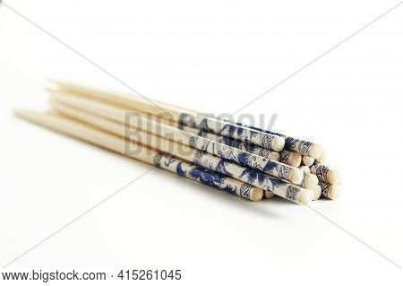 Wooden Chopsticks With Stacked Stack Pattern Isolated On White Background