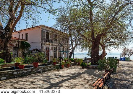 Afissos, Greece - March 28 2021: Panorama Of The Historic Argonauton Square Of The Village, With Old