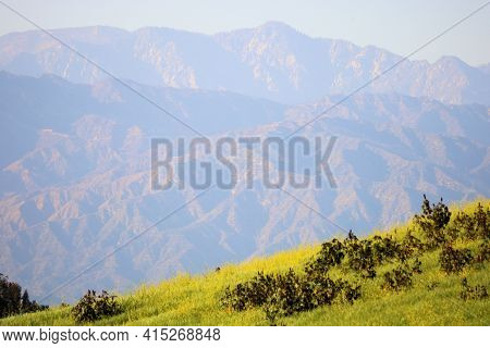 Sun Setting On The Rugged San Gabriel Mountains, Ca Taken On A Lush Hillside Covered With Grasslands