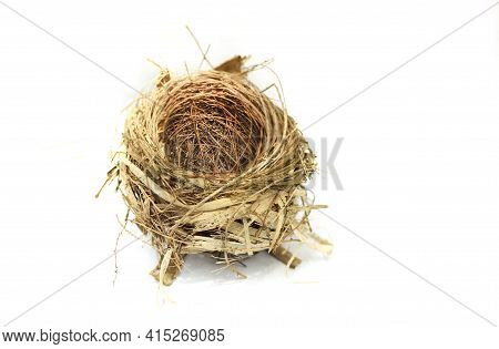 The Bird's Nest Is Laid Bare And Old Abandoned On A White Background, And There Is A Text Area.