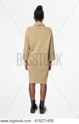Woman in long sleeve dress casual wear apparel rear view
