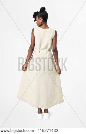 Woman in sleeveless dress casual wear apparel rear view