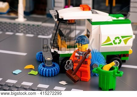 Tambov, Russian Federation - January 17, 2020 Lego Cleaner Minifigure With Brush Cleaning Street Nea