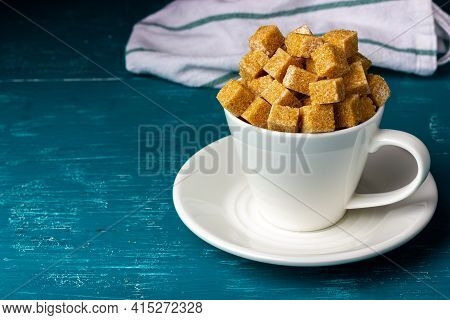 A Cup With A Slide Of Sugar. Granulated Sugar. Cane Sugar Cubes.