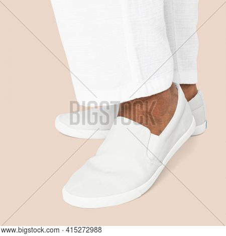 White slip-on shoes casual apparel close up with design space