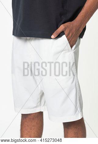 Man in white shorts summer fashion photoshoot close up