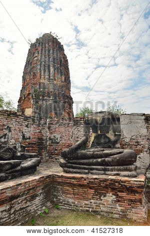 Pagoda And Statue Of The Buddha In Wat Phra Mahathat, Ayutthaya, Thailand