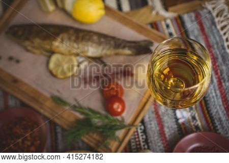Baked Fish Seabass With Fish Spices, Wine And Salad. Seafood In Restaurant. Top View. Healthy Eating