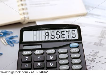 Calculator With The Word Assets On The Display. Money, Finance And Business Concept