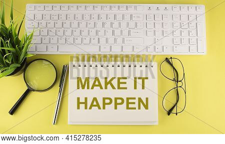 Office Desk Table Top View With Keyboard And Notebook Text Make It Happen On Yellow Background