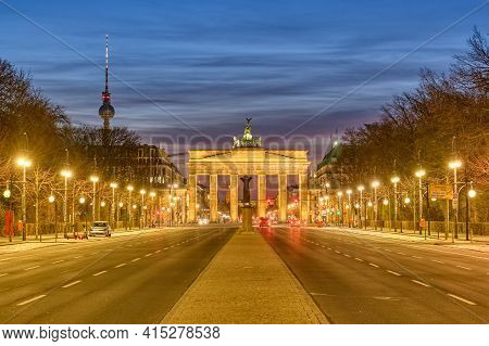 The Famous Brandenburg Gate In Berlin With The Television Tower At Dawn