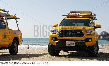 Oceanside, California Usa - 8 Feb 2020: Yellow Lifeguard Car, Beach Near Los Angeles. Coastline Resc