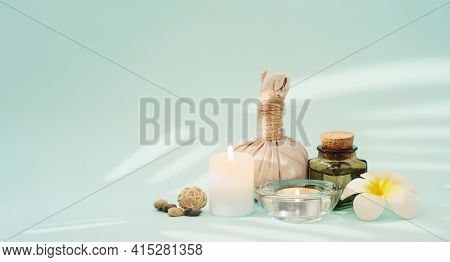 Concise Spa Composition With Candles, Flower, Oil Flask, Herbal Ball, And Other Decor Elements On Tu