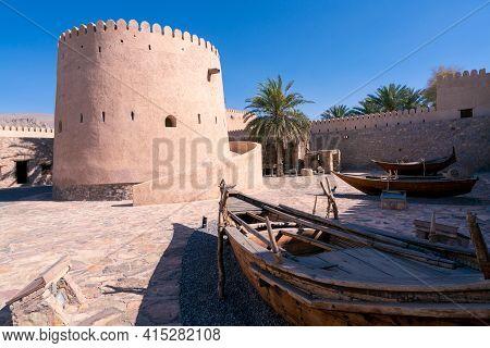 Khasab, Oman - 04.01.2018: Courtyard Of Medieval Arabian Fort In Khasab, Oman. Traditional Wooden Bo