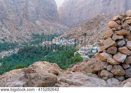 Arabian Mountain Village In The Gorge Of Wadi Tiwi, Oman. Oasis In A Dry, Deep Desert Valley.