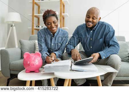 Happy African Couple Doing Retire Finances Plan And Money Budget