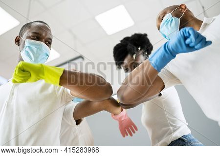 Janitor Cleaner Team In Uniform Elbow Bump