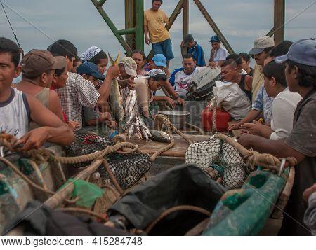 La Libertad, El Salvador. 11-18-2019. People Gather Around A Fisherman's Boat To Buy Fish After Retu