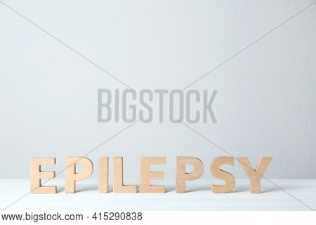 Word Epilepsy Made Of Wooden Letters On White Table. Space For Text