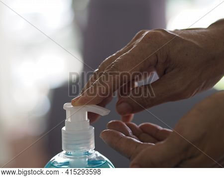 Push Gel Drops On Hand  Woman Holding Gel Hand Sanitizer, Gel Alcoholic Mixture With Gelatin In Clea