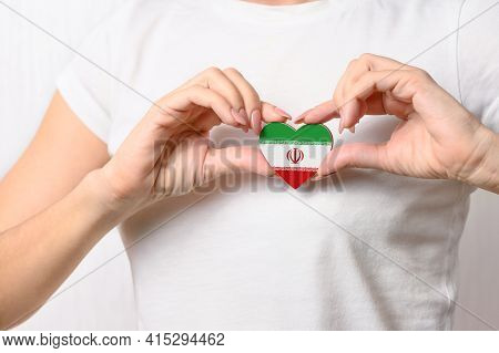 Flag Of Iran In The Shape Of A Heart In The Hands Of A Girl. Love Iran. The Concept Of Patriotism Fo