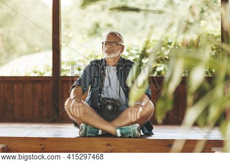 An Adult Man Sits On The Floor With His Knees Bent. Leg Pain, Rheumatism.