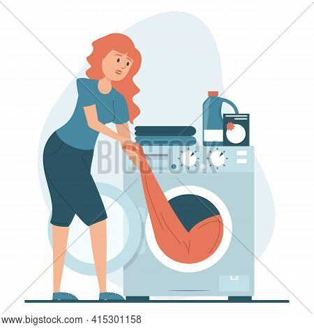Woman Puts Clothing In The Washing Machine