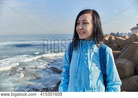 Woman Stands On Shore Of The Atlantic Ocean, Raging Waves Hitting The Shore, The Surf. Casablanca, M