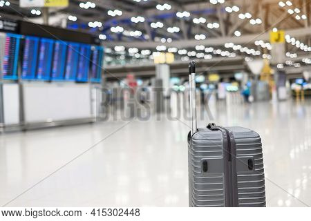 Luggage Bag In International Airport Terminal, Trolley Suitcase With Information Board In Aerodrome