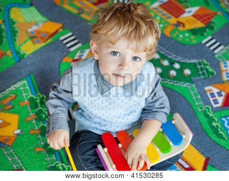 Little Toddler Boy Playing With  Music Toy