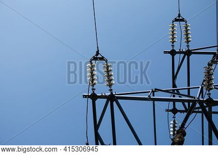 Power Lines. High Voltage Power Line Against The Blue Sky.