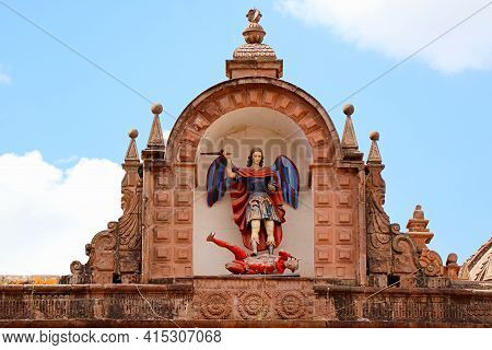 Impressive Statue Of Archangel Michael Slaying The Devil On The Facade Of Church Of The Triumph, His