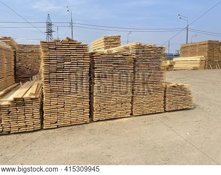 Wooden Boards Are Stored Outdoors. Wooden Boards, Lumber, Industrial Wood, Timber. Pine Wood Timber