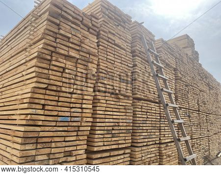 Close Up Of Wooden Boards On Background Of Blue Sky. Industrial Natural Timber Building Materials On