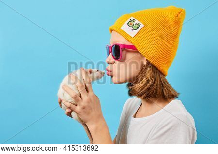 Sideways Shot Of Teen Girl Plays With Cute Rat, Touch Small Nose, Likes Animals. She Wears Casual Ye