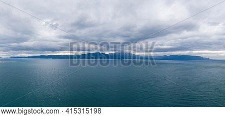 Great Blue Meeting Background. Where The Greek Blue Calm Sea Meets The Heavy Cloudy Sky. Destination
