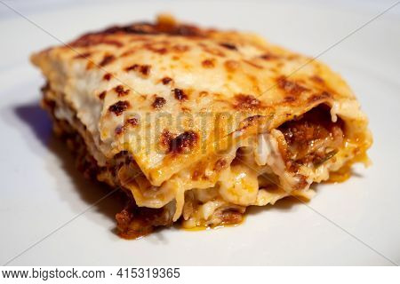 Lasagne Alla Bolognese, Baked With Meat Ragu On A White Plate